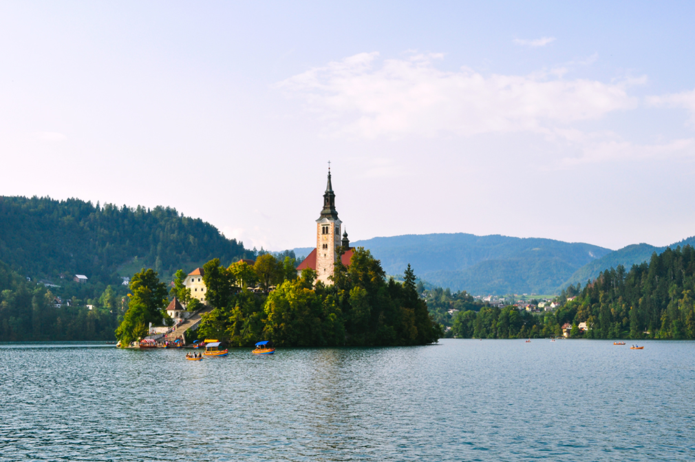 Chapel with steeple on a small island in a lake