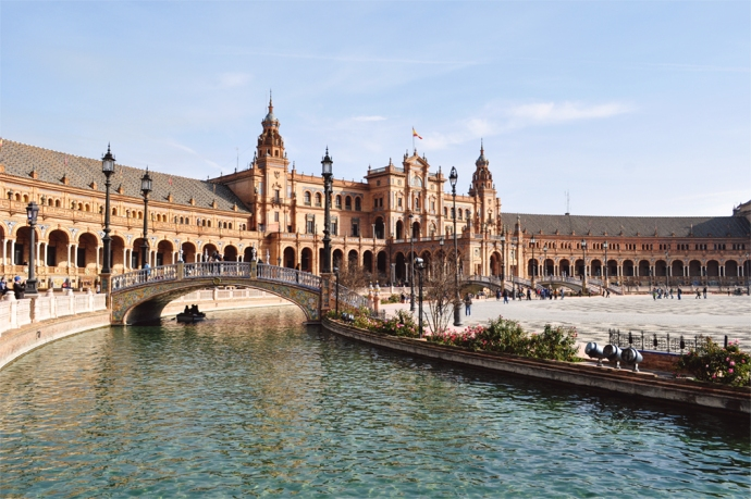 The iconic Spanish architecture of Seville's Plaza de España mixes neo-Mudéjar with neo-Renaissance elements