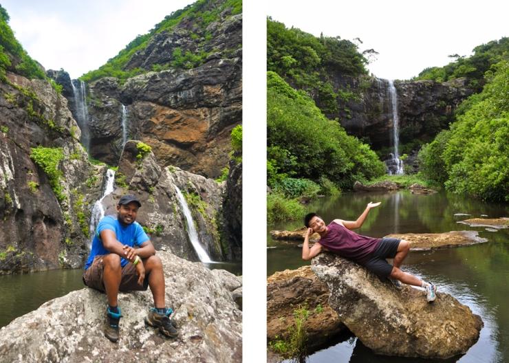 Young men posing in front of waterfalls