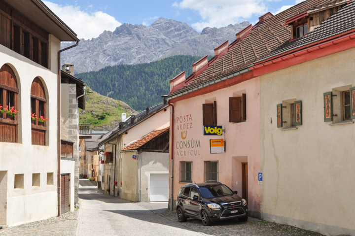 Car parked outside of an old postal building in a small Alpine village
