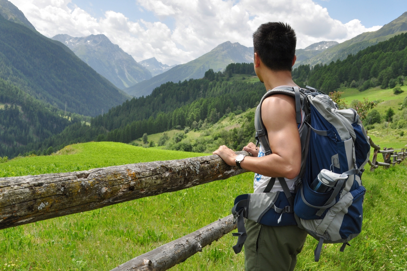 Man with backpack admiring mountain scenery