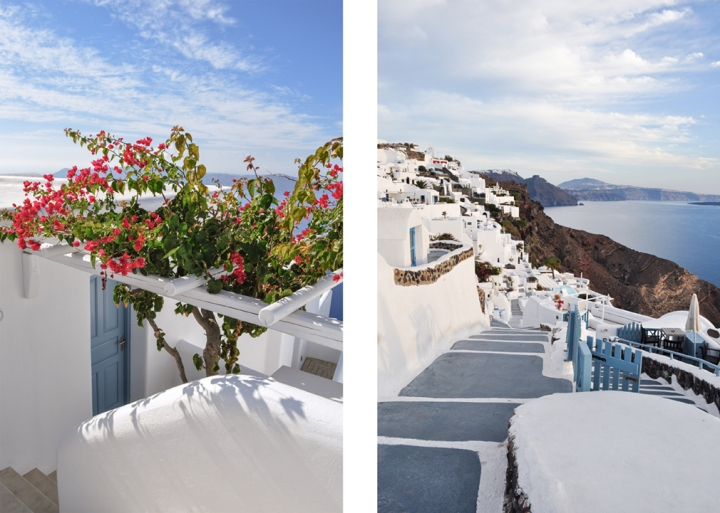 White stucco cave houses with bougainvillea and blue paint