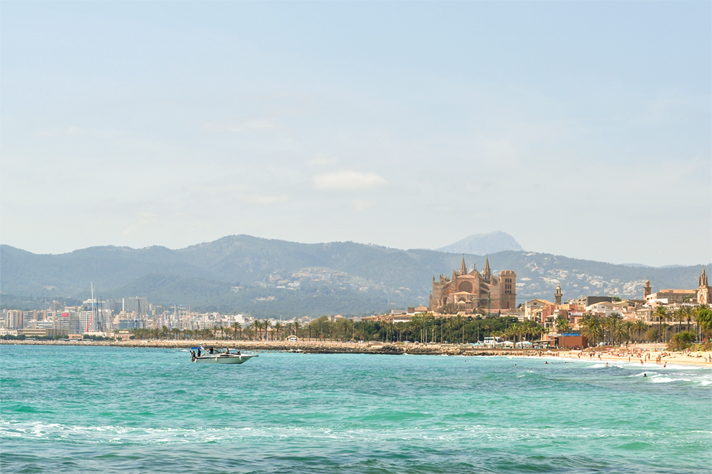 Beachside scene with towering cathedral