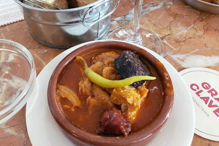 A Spanish dish consisting of tripe, chorizo, and blood sausage
