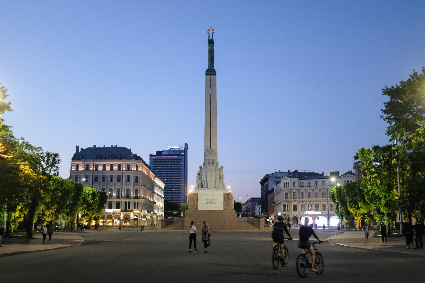 View of Riga's Freedom Monument at dusk