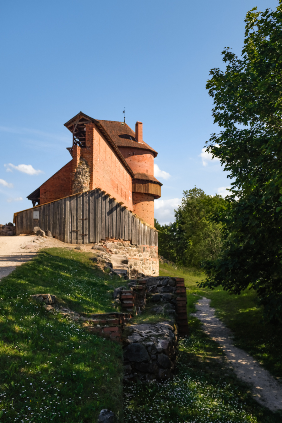 Side-view of castle constructed from red brick