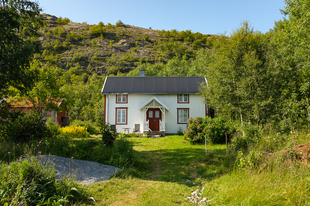 Restored white farmhouse in a pastoral countryside