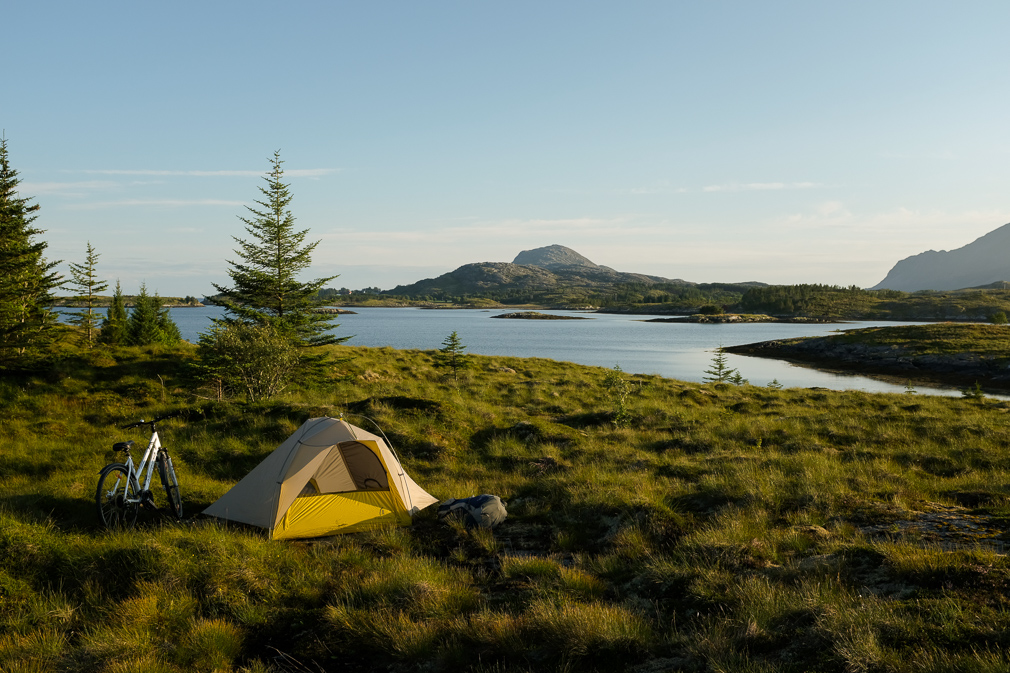 Tent and bicycle out in the wilderness