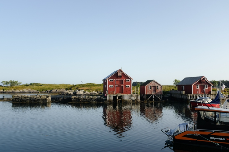 Old fishing cottages by a calm dock