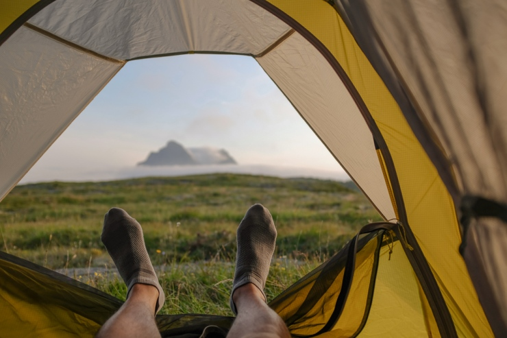 Pair of feet in a tent overlooking nature