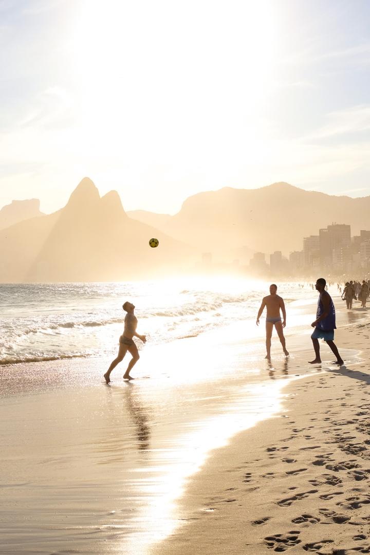 Men playing footvolley on Rio de Janeiro's Ipanema Beach