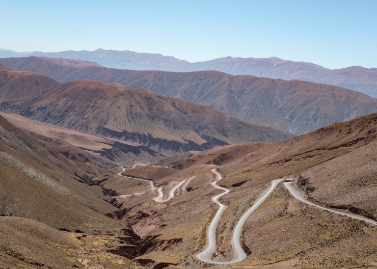 A winding road zigzagging up a canyon