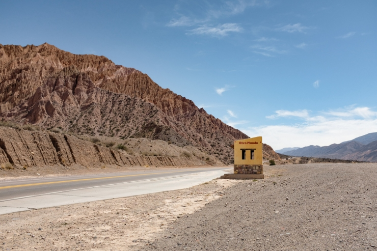 A painted bus stop in a desert landscape