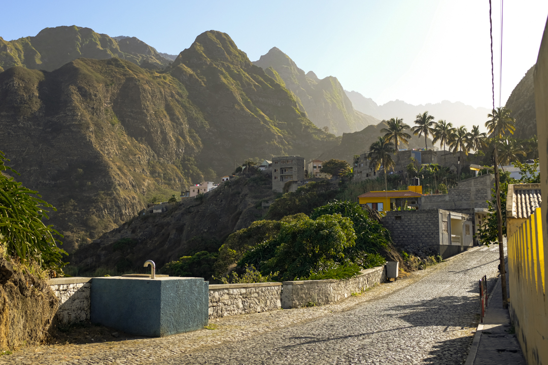 A village in a tropical and mountainous landscape