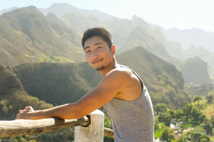 Man posing in front of mountain scenery
