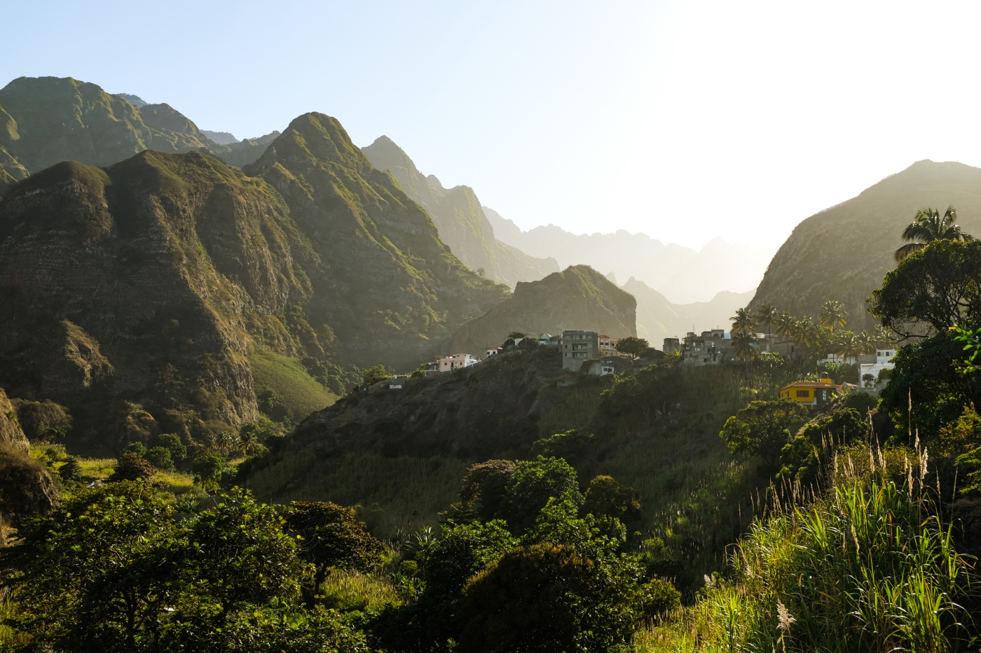 A village in a green mountain valley