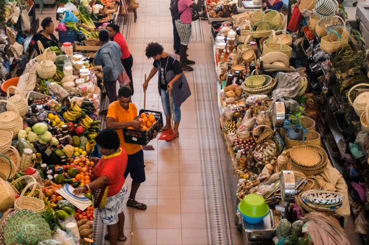 A busy fruit indoor fruit market seen from above