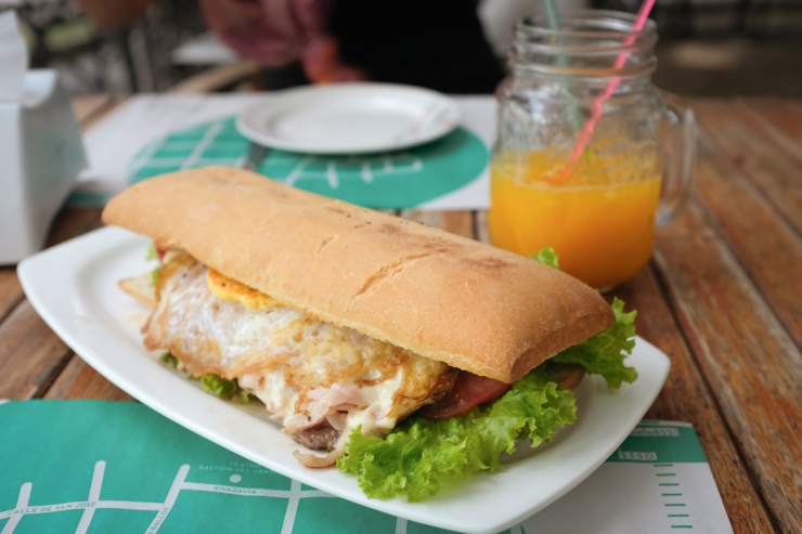 A Chivito, Uruguay's national dish consisting of a fried egg, strips of steak, tomato, and lettuce