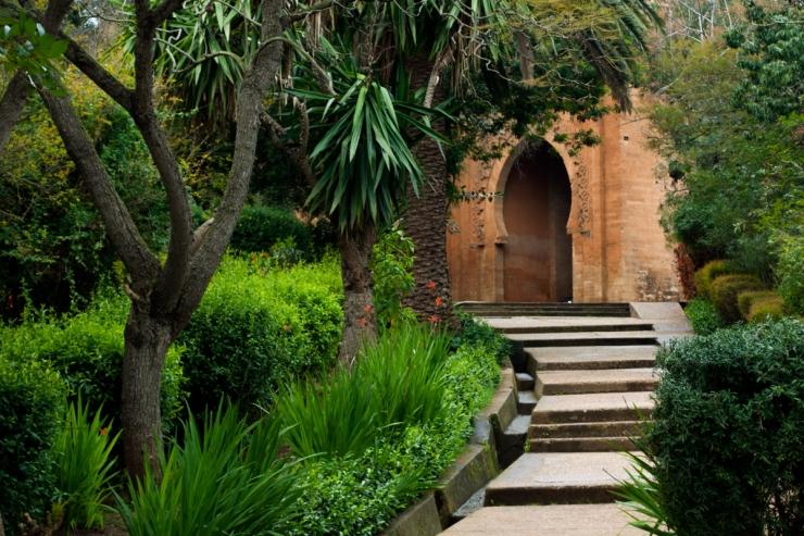 An Islamic archway in a green garden