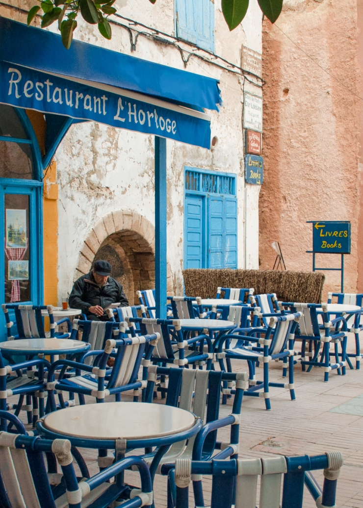 A cafe with blue patio chairs in Essaouïra, Morocco