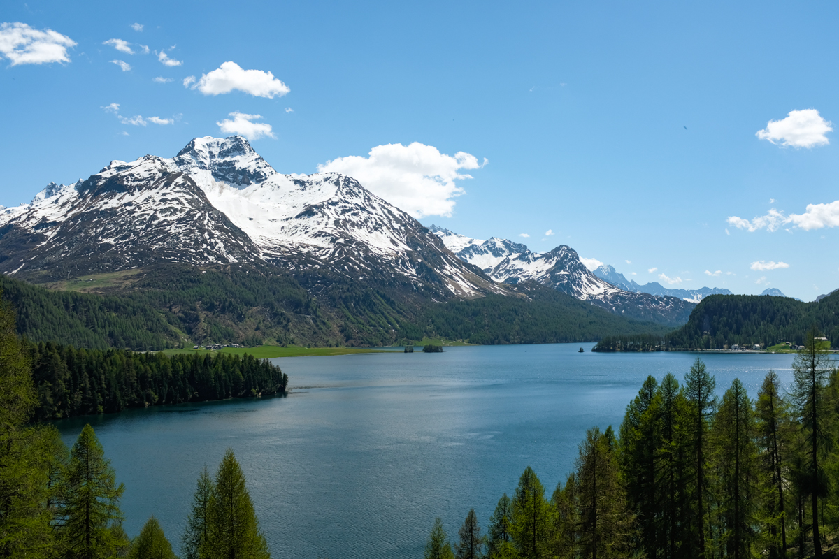 Panorama of a large mountain lake surrounded by forest