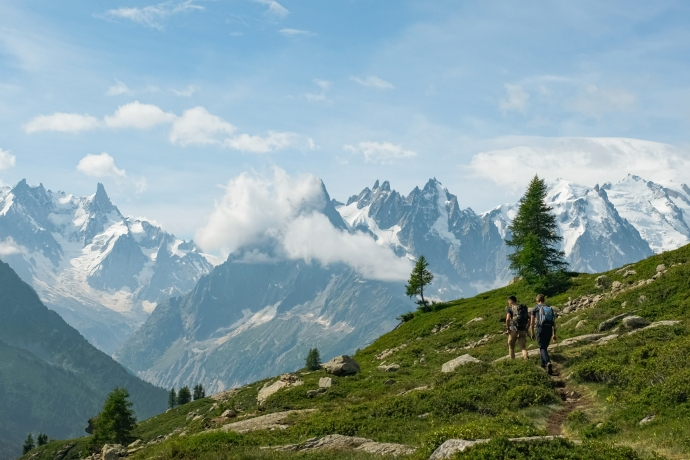 Two men hiking on a mountain path