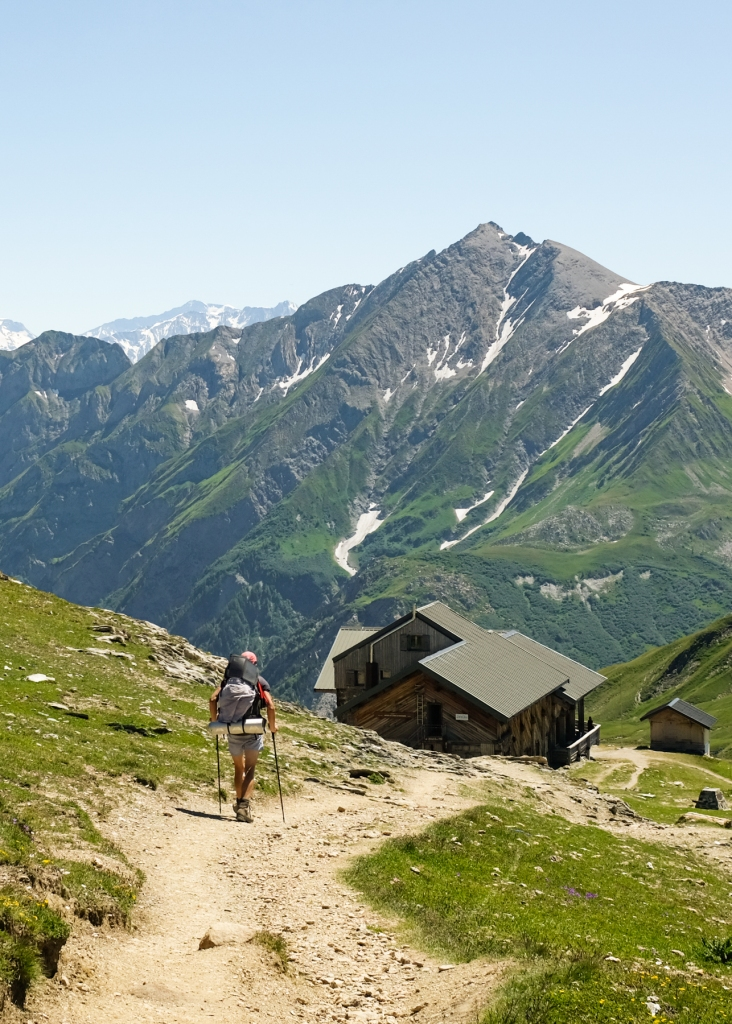Hiker descending down to a mountain hut