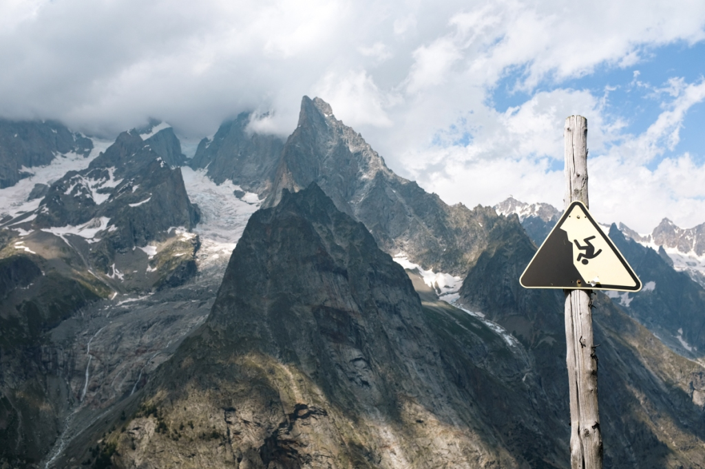 A danger sign in front of a glacial backdrop
