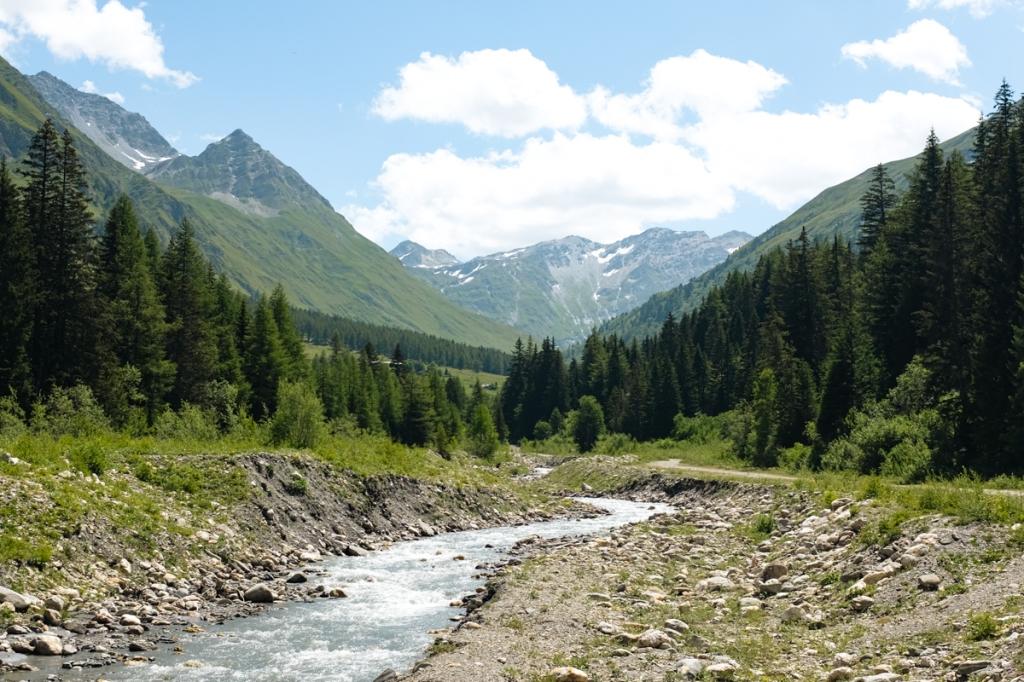 A river cuts through a mountain valley