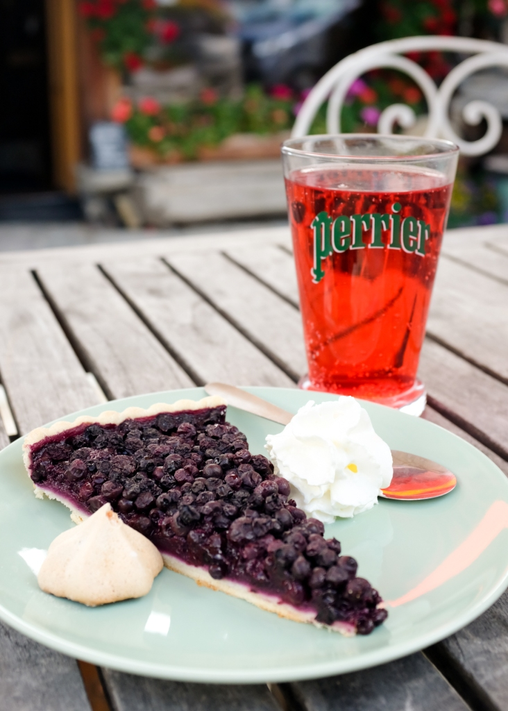 Close-up of a blueberry pie and strawberry soda