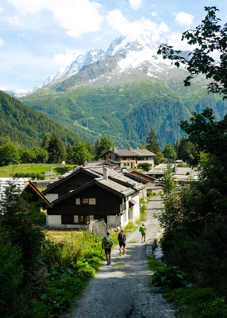 Hikers descending down into a village