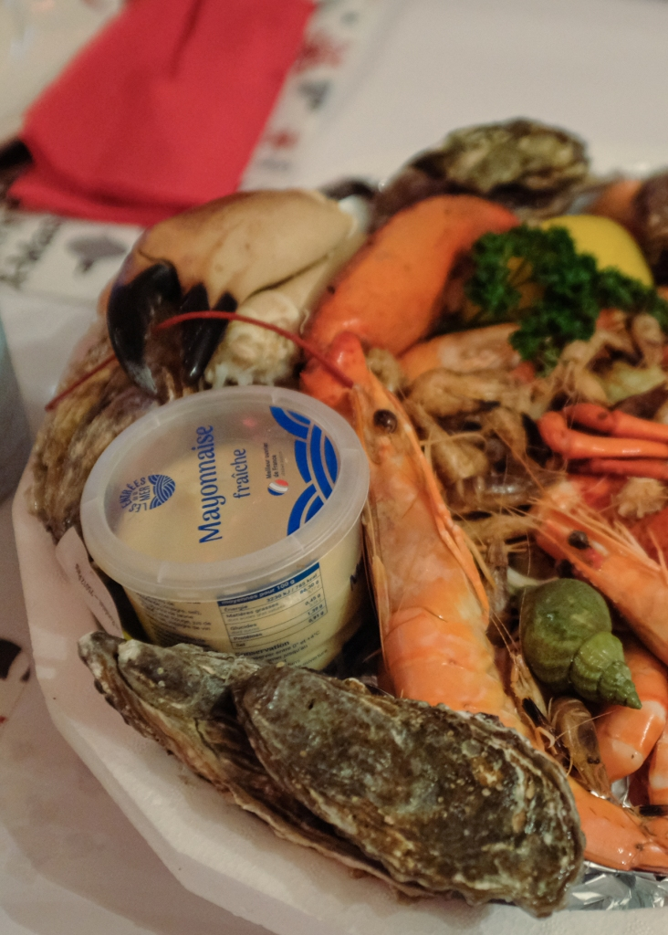 A platter of oysters, shrimp, crabs, and whelks