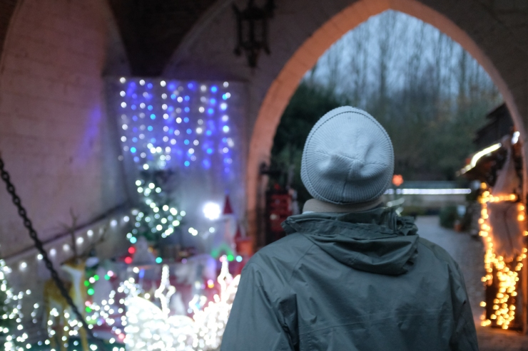A man admiring Christmas decorations